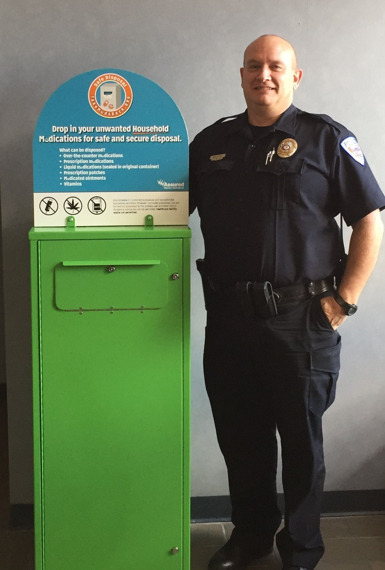 FMPD Officer Roger Doll with the police department's new medication drop box